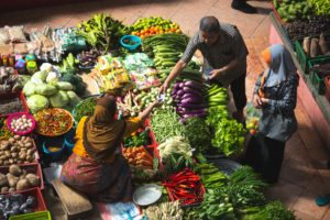 vegetables at market, three people in sales process