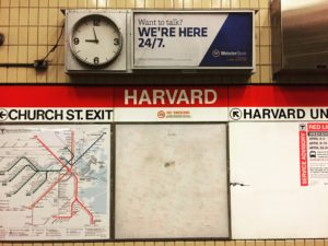 harvard university subway sign on wall